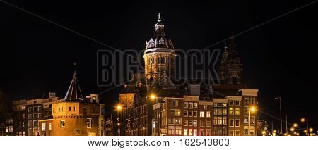 View of the city with Church of St.Nicholas and Schreierstoren     at night during Light Festival