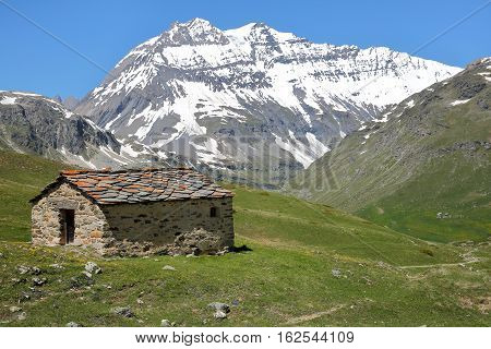 VANOISE, FRANCE: View of Grande Casse from St Barthelemy Chapel near the Plan du Lac refuge, Northern Alps