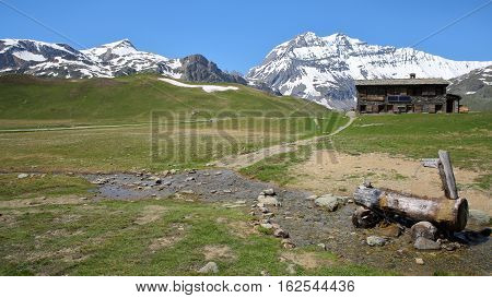 VANOISE, FRANCE - JUNE 23, 2016: Plan-du-Lac refuge with Two summits (Rechasse and Grande Casse) in the background, Northern Alps