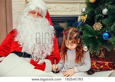 Little Girl Writes A Letter To Santa.