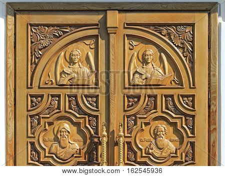 Sochi Russia - August 24, 2016: carved well decorated door in orthodox church in Sochi Russia