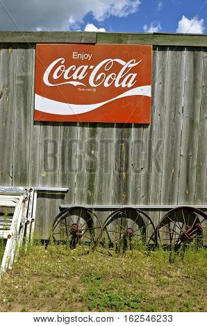 DETROIT LAKES, MINNESOTA, July 27, 2016: The old Coca Cola  sign advertise the soft drink invented by John Pemberton in the late 1800's is headquartered in Atlanta, GA.