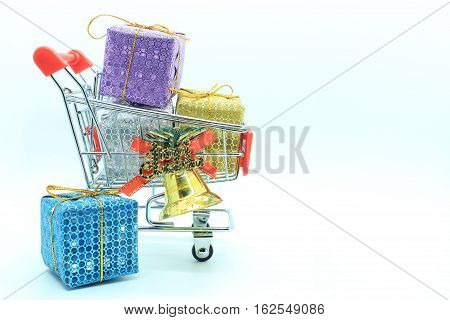 single supermarket trolley or shopping cart with colorful four gift boxs and golden bell for use in decorating the Christmas and New Year's Day. or can be used with shopping at the supermarket in other special days.