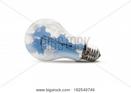 An metaphoric image about creativity and reasoning featuring a light bulb filled with a sky overlay isolated on white background