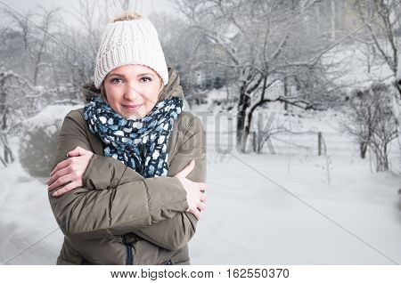 Beautiful Woman Feeling Cold Outside In Snowy Day