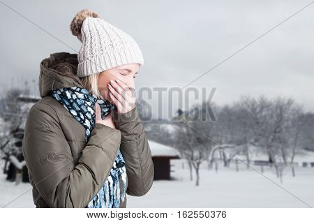 Sick Young Woman Sneezing And Having Throat Pain