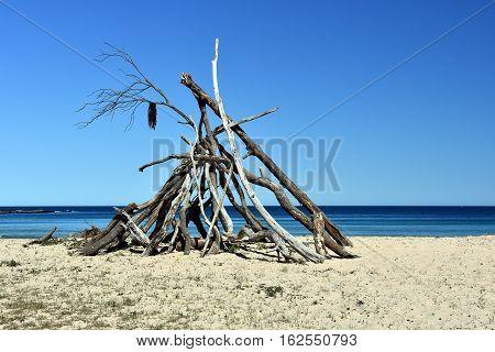 Hot dry Sunny day on Pebbly beach NSW Australia. Branch hut on the South coast.
