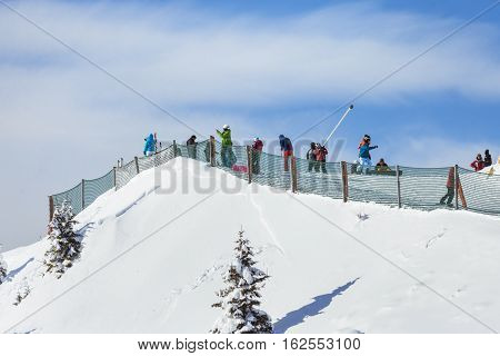 Poiana Brasov Romania - January 24 2016: People skiing on the ski covered with snow in the winter season in the mountain resort of Poiana Brasov Romania