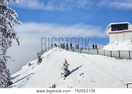 People skiing on the ski covered with snow in the winter season in the mountain resort of Poiana Brasov Romania