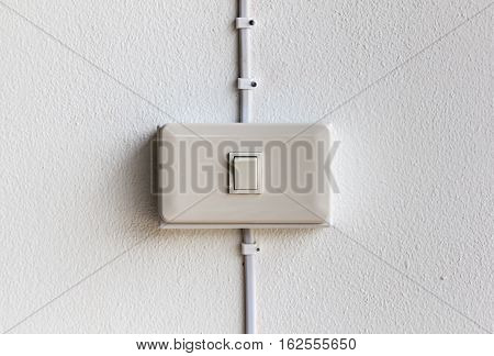 close up of lighting switch on white concrete background