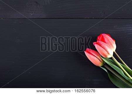 Tulips. Red tulips on wooden background. Tulip and heart.. Red tulips Bouquet of tulips for love. Tulips in bouquet beautiful tulipsRed tulips with green tulips tulips.Tulips card with copy space.