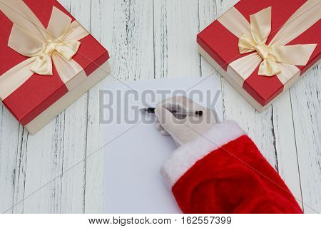 Santa Claus writing on a blank paper good for letter or advertisement