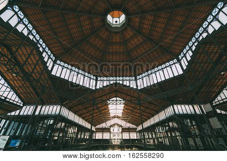 BARCELONA SPAIN - JUNE 2 2016. View from inside of cultural center El Born. Old City Market museum roof with people watching exhibition inside captured on wide angle lens