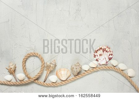 Rope And Shells On The Textured Light Background