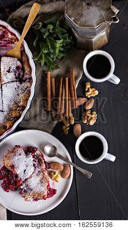 Cherry pie and a cup of coffee. Rustic style. Berry pie. Homemade cherry pie with flaky crust cup of coffee bowl with cherries