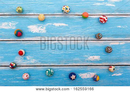 Collection of rubber bounce balls on wooden blue background