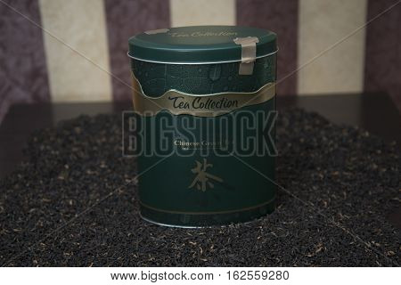 Black And Green Tea In A Tin Box.