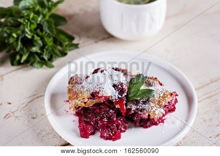 Cherry pie and a cup of tea. Rustic style. Berry pie. Homemade cherry pie with flaky crust cup of coffee bowl with cherries