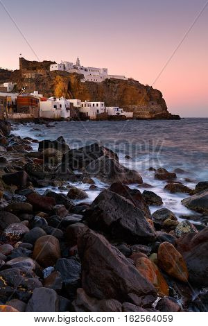 View of a monastery and Mandraki village seafront early in the morning.