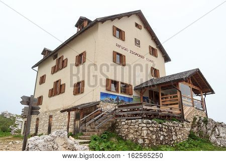 Sexten, Italy - August 1, 2016: Alpine Hut Zsigmondyhütte in Sexten Dolomites. The Zsigmondyhütte is a mountain hut on the rock ridge of the Zwölferkofel. The hut is named after the 	Viennese alpinist Emil Zsigmondy.