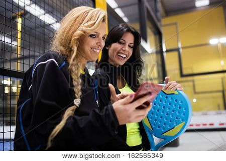 Paddle Tennis Team Using Mobile Phone After The Match.