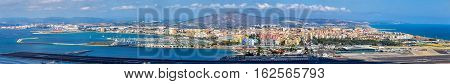 Panorama of La Linea de la Concepcion and Gibraltar Airport from the city of Gibraltar