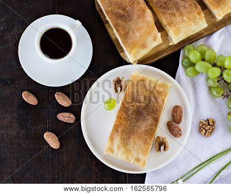 Сheese pie strudel with cheese cheese pie 4. Wine grapes nuts cheese blue cheese and coffee. dinner lunch romantic date picnic eating on nature.