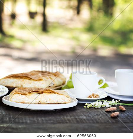 Сheese pie strudel with cheese cheese pie 4. Wine vinogdad nuts cheese blue cheese and coffee. dinner lunch romantic date picnic eating on nature.