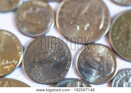 The money of the United States. Old coins. Rare. Historical. Most of coins are blurred.