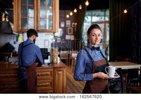 Waitress, a waiter working at cafe bar restaurant.