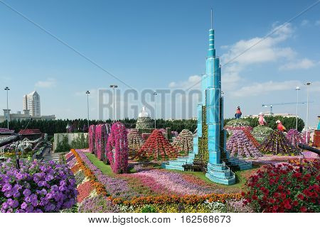 DUBAI, UNITED ARAB EMIRATES - DECEMBER 8, 2016: Dubai Miracle Garden is the biggest natural flower garden in the world with wide variety of different flowers arranged in shapes of hearts, stars, igloos, pyramids and other figures.