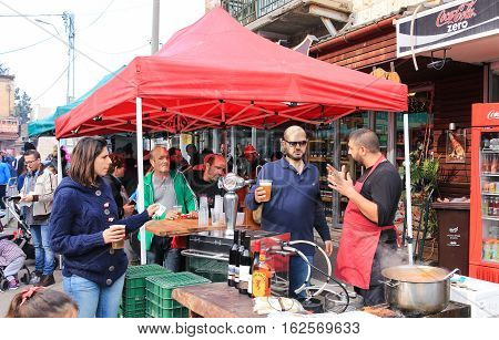 Seller Of Alcoholic Beverages Pours Beer For The Buyer