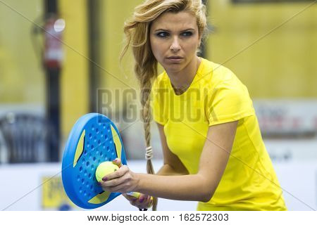 Beautiful Young Woman Playing Paddle Tennis Indoor.