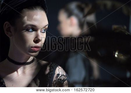 Moscow, Russia - October 21, 2016: Backstage of Moscow fashion week. Model in sexy dresses lingerie.
