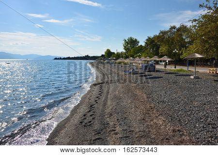 Evening on the pebble beach in Paralia Politikon Aegean sea Greece