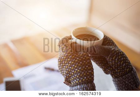 Employee woman drinking morning tea of coffee. Coffee break during working day, advertising business concept