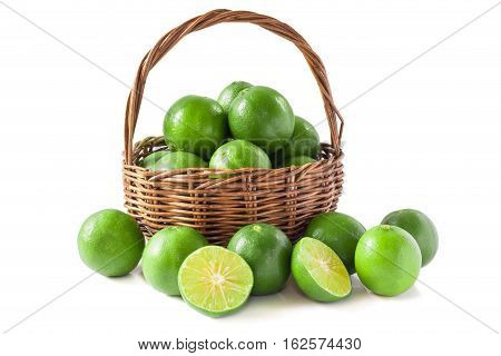 Green Lemon In The Basket Isolated Background