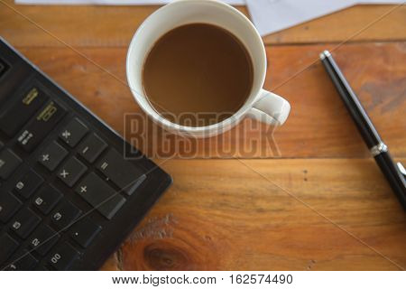 Coffee cup and laptop for business, Selective focus on coffee and using filter photo effect.