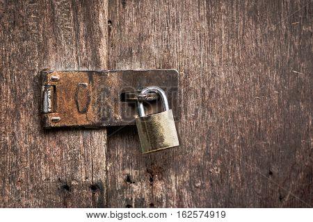 Old master key rusty lock wooden door.