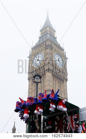LONDON ENGLAND - DECEMBER 17: London Big Ben and British souvenirs stall. In London England. On 17th December 2016.