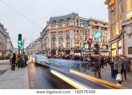 LONDON ENGLAND - DECEMBER 17: Oxford Circus London - busy with Christmas shoppers. In London England. On 17th December 2016.