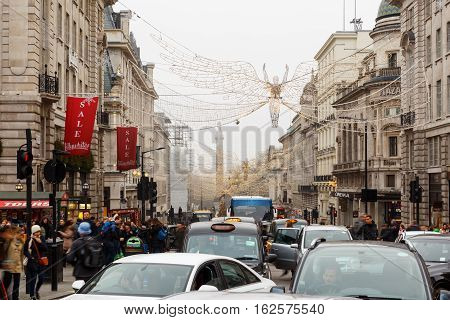 LONDON ENGLAND - DECEMBER 17: Christmas lights and traffic on Regent Street London. In London England. On 17th December 2016.