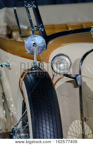 Closeup With Retro Car. Vertical Background With Part Of Beautiful Brown Old Car With Headlamp. .