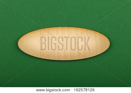 Ellipse Shaped Wooden Sign On Green Background