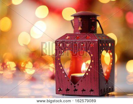 Red Christmas lantern. Bokeh background golden light.