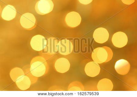 Christmas holiday lights bokeh background. Golden blurred light.