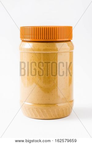 Creamy peanut butter jar isolated on white background