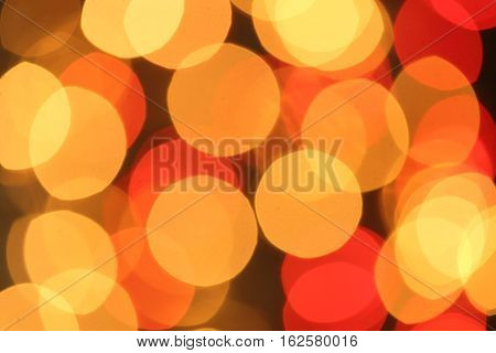Golden and red Christmas lights blurred in the background