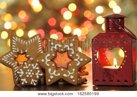 Christmas gingerbread cookies on a blurred background of lights