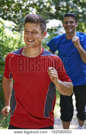 Two Smiling Men Running In Countryside Together